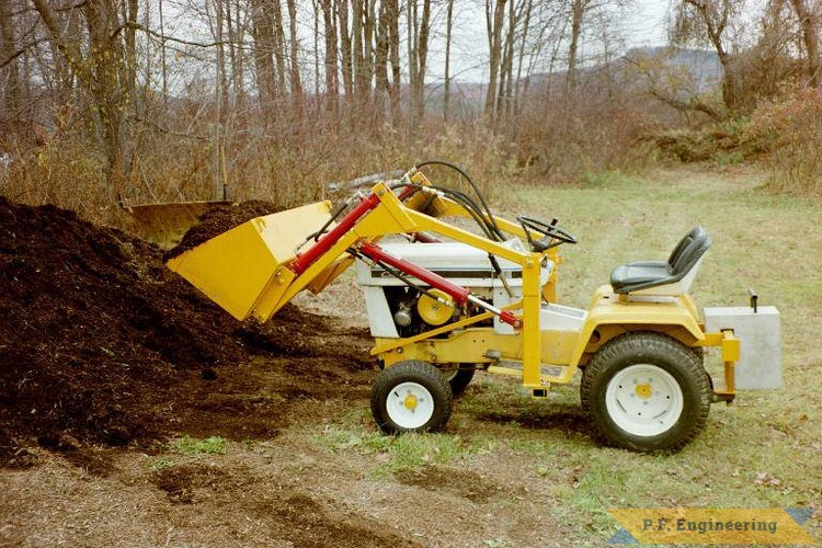 Paul's Cub Cadet 149 with front-end loader attachment.
