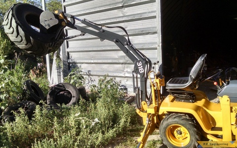 John Deere 318 Micro Hoe with thumb attachment by Jake T.