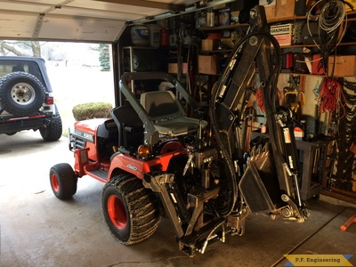 Kubota BX2200 micro hoe on the tractor by Mark J.