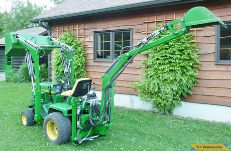 John Deere 318 Micro Hoe Loader rear view by Walter K., Pointe Claire, Quebec, CN